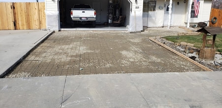 new concrete slab being poured to replace an old broken driveway, the concrete is removed and ready to be poured